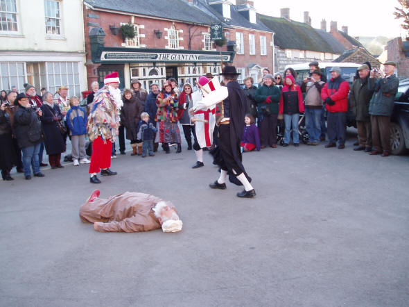 Picture of the mummers play being performed at Cerne Abbas
